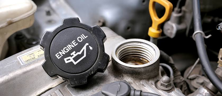 With the engine off, check under the oil cap